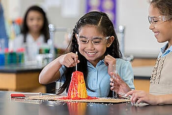 Girl with volcano experiment